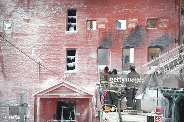 Firefighters brave singledigit temperatures to battle a 4alarm fire at a vacant warehouse in the 1800 block of 54th Avenue on January 22 2014 in...