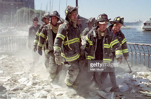 FDNY firefighters carry fellow firefighter Al Fuentes who was injured in the collapse of the World Trade Center on Sept 11 2001