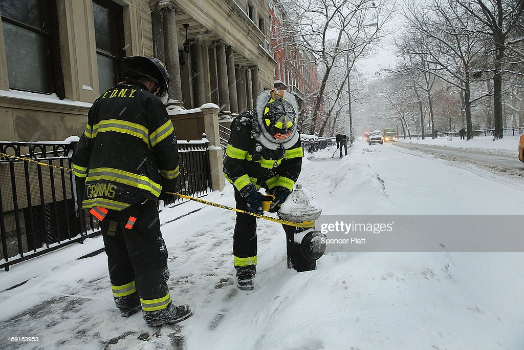 Firefighters close off a street due to a manhole explosion on February 13, 2014 in New York City. In what is turning out to be one of the snowiest winter's in recent memory for New York City and much of the East Coast, Thursday's weather is expected to bring a wintery mix of sleet and snow with total accumulation of 6 to 8 inches of snow before ending early Friday morning.