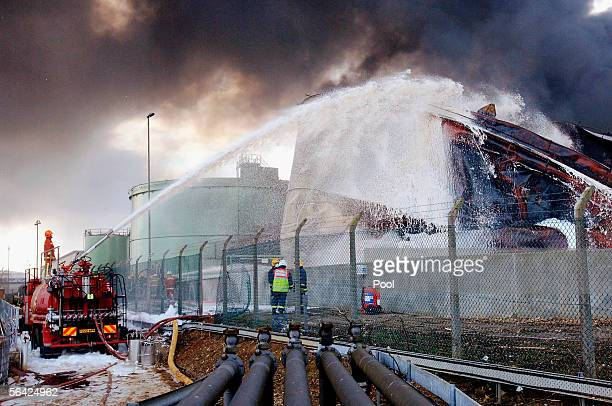 Firefighters continue to battle the raging fires at Buncefield oil depot as they continue to burn for a third day on December 13 2005 in Hemel...