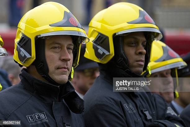 Firefighters demonstrate outside the Houses of Parliament ahead of a TUC organised rally protesting against the Trade Union Bill in London on...