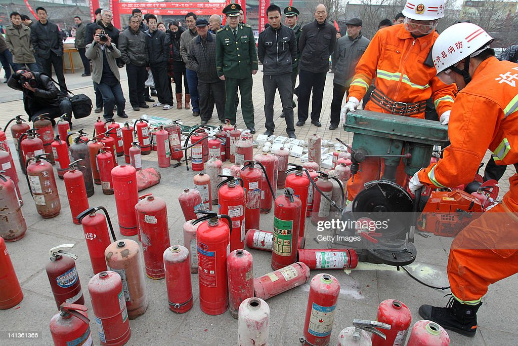 Firefighters destroy illegal fire extinguishers on March 15, 2012 in Xuchang, China. China marks World Consumer Rights Day (WCRD) on March 15 each year, aiming to protect consumer rights and interests. The theme for WCRD 2012 is 'Our money, our rights: campaigning for real choice in financial services'.