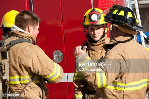 Firefighters Discussing Operational Procedures In Front of Firet
