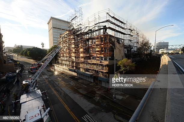 Firefighters douse flames at the remains of the DaVinci apartment complex after a fire destroyed the 1 million square foot site in Los Angeles...