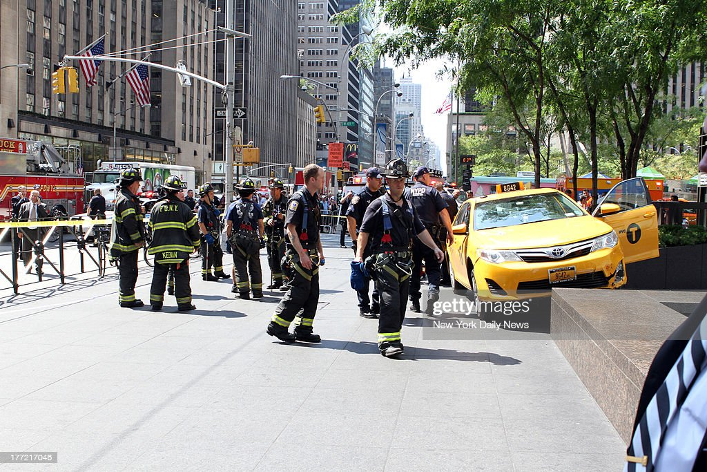 Firefighters, Dr. Oz and bystanders rushed to tourist Sian Green struck by out-of-control taxi cab on Sixth Ave. and W. 49th St. Bike messenger Kenneth Olivo said cabbie lost contol after hitting his bike.