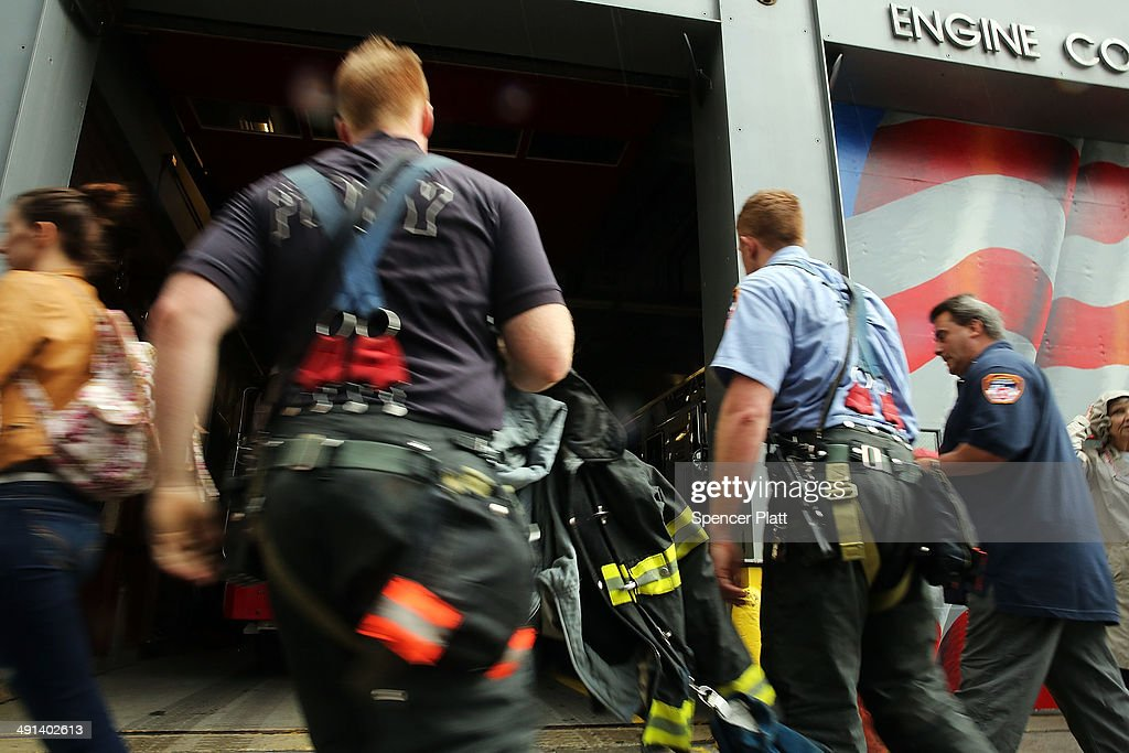 Firefighters enter a firehouse just outside the ground zero memorial site after authorities opened the plaza to the public free of charge on May 16, 2014 in New York City. Prior to today, visitors had to wait in line to enter a barricaded area which includes the newly dedicated National September 11 Memorial Museum. Together with the museum, Ground Zero has become one of the top tourist attractions in the nation with tens of thousands of visitors expected yearly.
