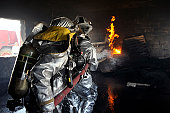 August 9, 2010 09/14/2009 Firefighters extinguish a fire in a training room during live burn training at Baghdad International Airport, Iraq. Firefighters from the 447th ECES, BIAP and Iraqi Air Force