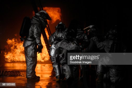 Firefighters extinguish a simulated cargo fire at RAF Mildenhall, England. : Stock-Foto