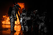 March 8, 2008 - A 48th Civil Engineer Squadron firefighter instructs fellow firefighters to advance towards the simulated cargo fire at RAF Mildenhall, England.