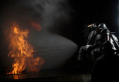 March 8, 2008 - 48th Civil Engineer Squadron firefighters extinguish a simulated battery fire inside an aircraft fire trainer at RAF Mildenhall, England. Firefighters must train constantly to stay pro
