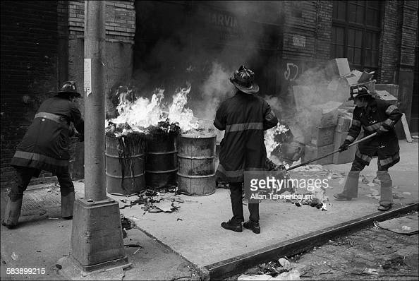 Firefighters extinguish a trash fire on Crosby Street on SoHo New York New York July 5 1979