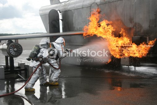 Firefighters Extinguish An Exterior Fire During A Training Exercise Stock Photo Thinkstock
