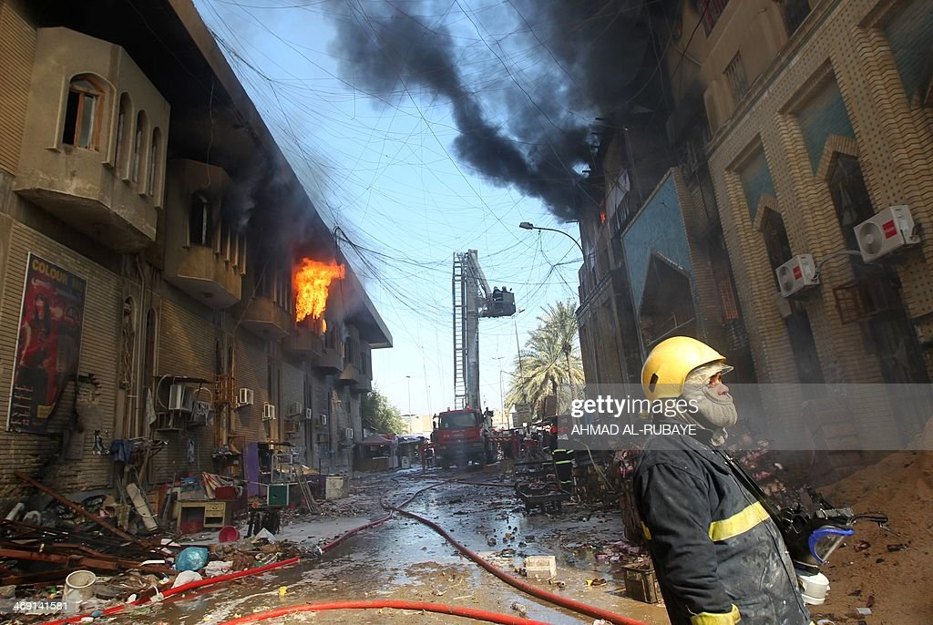 Firefighters extinguish fire from Baghdad's historic Shorjah market, which dates to the Abbassid era over 700 years ago, after it was hit by two bomb blasts on February 13, 2014 killing at least two people and wounding at least 11. Violence in Iraq has reached a level not seen since 2008, when it was just emerging from a period of brutal sectarian killings. AFP PHOTO/AHMAD AL-RUBAYE
