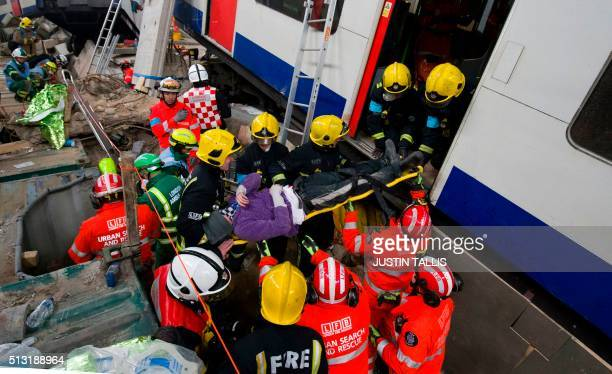 Firefighters extricate a 'casualty' played by an actor on a stretcher from a London Underground train during the Exercise Unified Response planned...