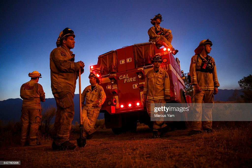 Firefighters from Cal Fire's Sonoma-Lake-Napa Unit pay close attention to the wildfire coming at every direction in Kelso Valley as the wildfire progresses east with the winds, near Lake Isabella, Calif., on June 24, 2016.
