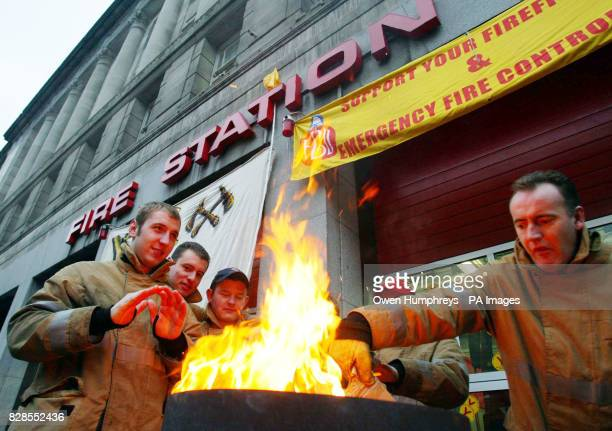 Firefighters from Pilgrim street Fire Station in NewcastleuponTyne stand in front of a brazier after striking at the start of eight days of...