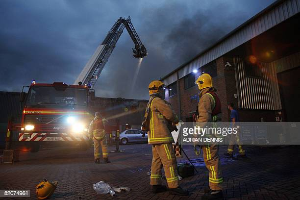 Firefighters from Surrey fire brigade tackle a fire at MY Healthcare a pharmaceutical packaging company near Egham some 25 miles west of London on...