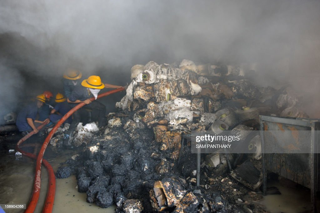 Firefighters from the Ahmedabad Fire and Emergency Services control a blaze which broke out at the United Poly Fab premises on the Pirana-Narol highway near Ahmedabad on January 3, 2013. The cause of the fire is under investigation. AFP PHOTO / Sam PANTHAKY