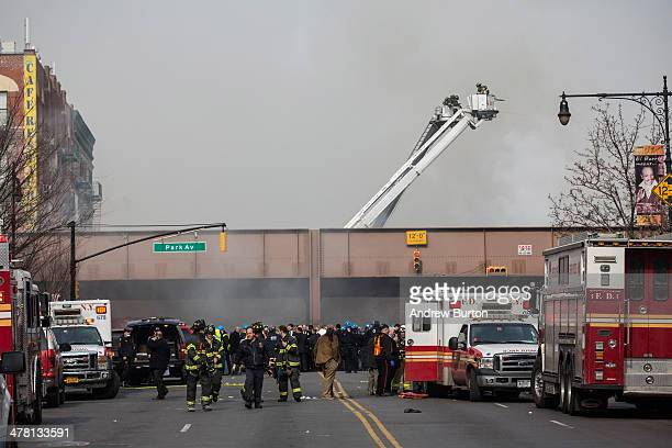 Firefighters from the Fire Department of New York respond to a 5alarm fire and building collapse at 1646 Park Ave in the Harlem neighborhood of...