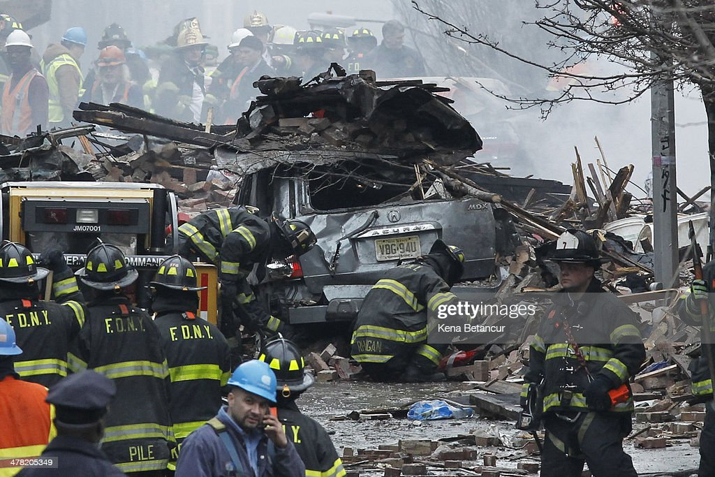 Firefighters from the Fire Department of New York (FDNY) respond to a five-alarm fire and building collapse at 1646 Park Ave in the Harlem neighborhood of Manhattan March 12, 2014 in New York City. Reports of an explosion were heard before the collapse of two multiple-dwelling buildings that left at least 17 people injured.