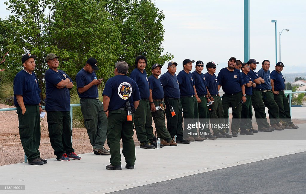 Firefighters from the San Carlos Fuels crew line up as they wait for their vehicles to be inspected after arriving at the incident command post for the Carpenter 1 fire at Centennial High School on July 10, 2013 in Las Vegas, Nevada. More than 25,000 acres have burned since lightning sparked the blaze in Carpenter Canyon on the Pahrump, Nevada side of Mount Charleston on July 1. More than 1,000 firefighters are battling the wildfire which crested the peak of Mount Charleston on July 4, prompting the evacuation of 520 people as it began descending the east side of the mountain, about 35 miles northwest of Las Vegas. The fire is 10% contained and fire officials estimate that they won't have it fully contained until July 19.