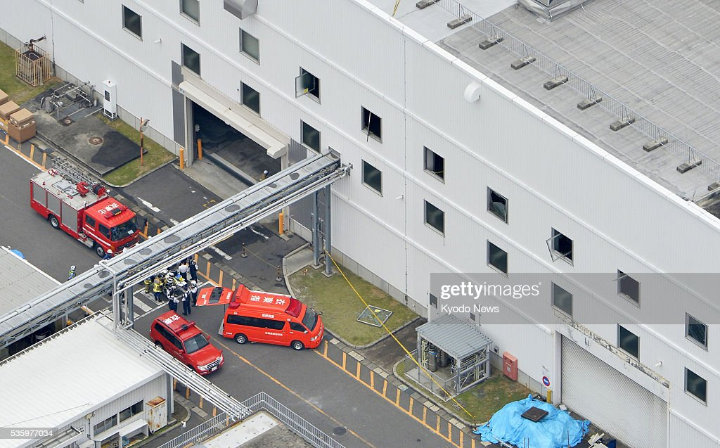 Firefighters gather at the site of an explosion at an auto parts factory operated by Advics Co., a unit of Aisin Seiki Co., in the central Japan city of Kariya, Aichi Prefecture, on May 30, 2016. Four people were injured in the explosion, according to police.