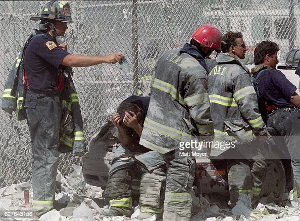 Firefighters gather near ground zero after the attack on the World Trade Center on Sept 11 2001