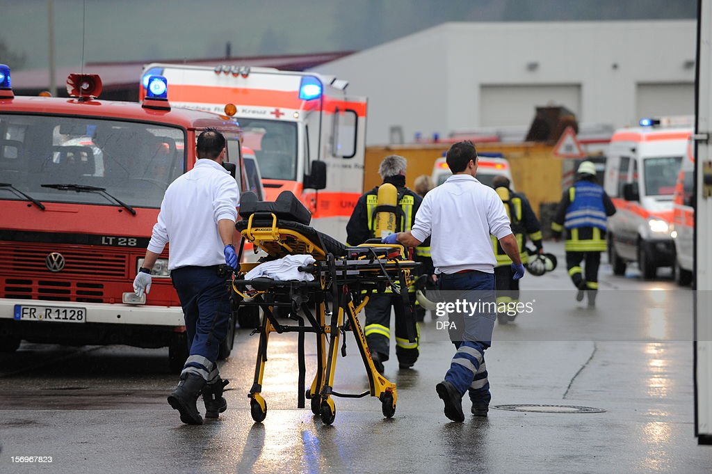 Firefighters go to house with a workshop for handicapped people in Titisee- Neustadt, southern Germany on November 26, 2012. Fourteen people died after a fire broke out.
