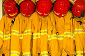Firefighters in yellow fire-proof uniform