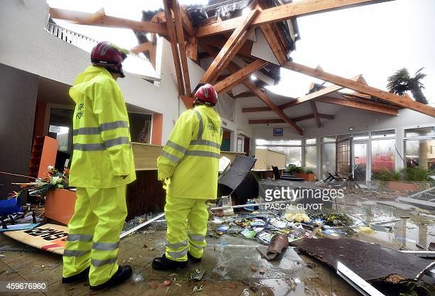 Firefighters inspect the damage at the Aloha camping site after a mini tornado ripped through SerignanPlage in southern France on November 28 2014...