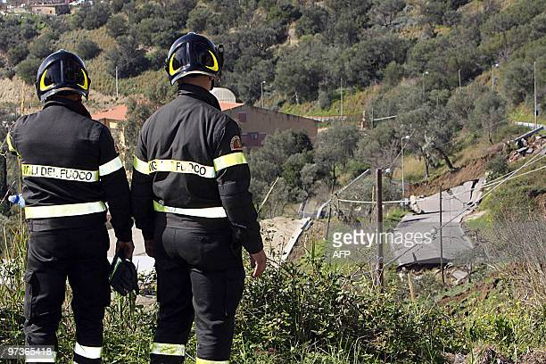 Firefighters look at devastated area after a landslide due to heavy rains on March 2 2010 in Caronia 130km near Messina the Italian island of Sicily...