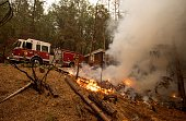 Firefighters manage a backfire while trying to protect a house during the Valley fire in Seigler Springs California on September 13 2015 The governor...