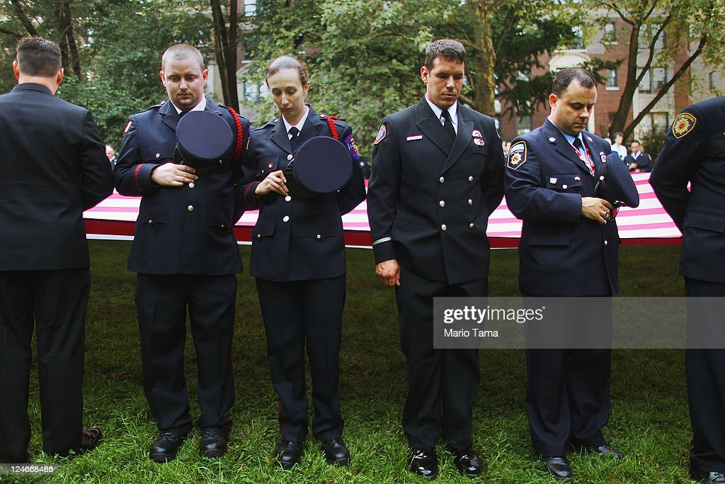 Firefighters observe a moment of silence at a memorial service for firefighters killed on the 10th anniversary of the terrorist attacks on lower Manhattan at the Firemen's Monument at Riverside Park on Septemnber 11, 2011 in New York City. Firefighters from around the world have converged on New York to take part in the anniversary services. New York City and the nation are commemorating the tenth anniversary of the terrorist attacks which resulted in the deaths of nearly 3,000 people after two hijacked planes crashed into the World Trade Center, one into the Pentagon in Arlington, Virginia and one crash landed in Shanksville, Pennsylvania.