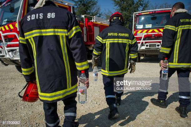 Firefighters of the SDIS 86 Vienne use Jolival water bottles with labels promoting a recruiting campaign for volunteers during an exercise in...