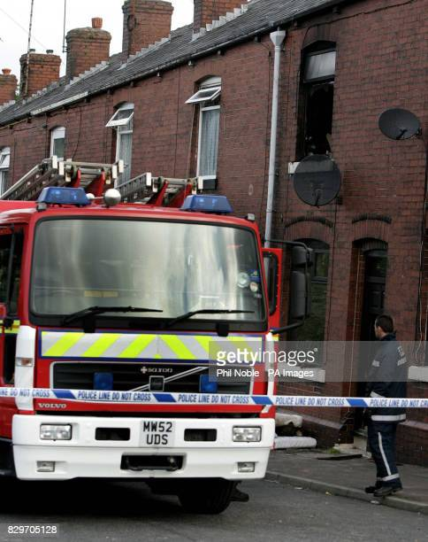 Firefighters outside the midterraced house in Albion Road Rochdale Greater Manchester where three children died in a blaze overnight A threeyearold...