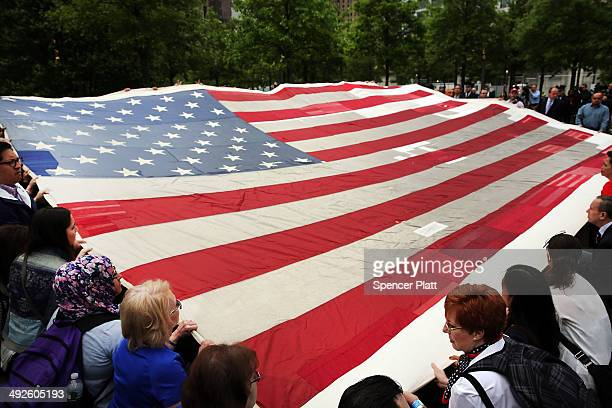 Firefighters police members of the military and the public participate in the ceremonial transfer of the National 9/11 Flag into the The National...