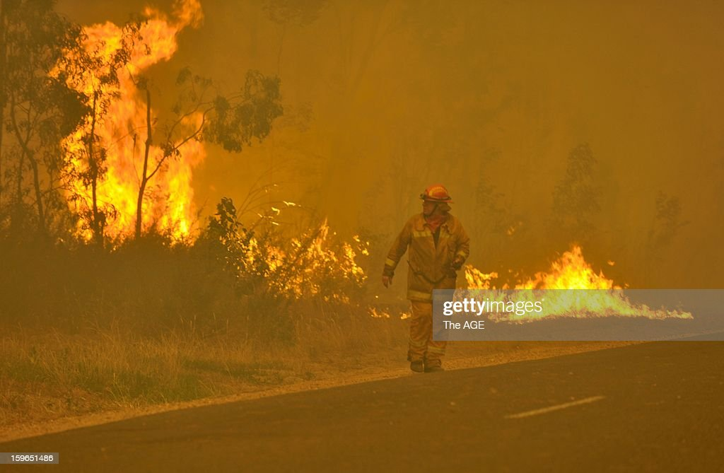 Firefighters prepare to defend the Glenmaggie Caravan Park in the large rural region of Gippsland January 18, 2013 near Glenmaggie, Victoria, Australia. Record heat was making conditions ripe for wildfires throughout Australia. Australia's largest city Sydney today posted its highest recorded temperature ever at 114 degrees Fahrenheit.