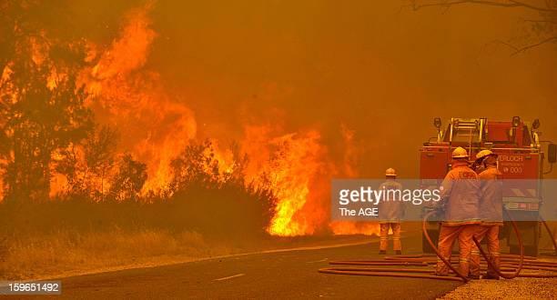 Firefighters prepare to defend the Glenmaggie Caravan Park in the large rural region of Gippsland January 18 2013 near Glenmaggie Victoria Australia...