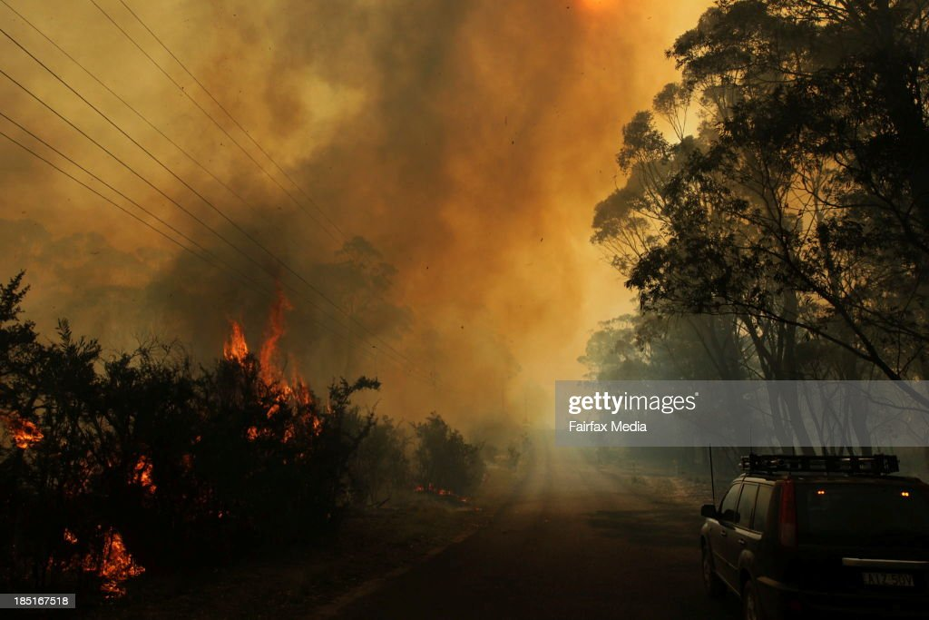 RFS firefighters protect properties, on October 17, 2013 in Clarence, Australia. One man has died and dozens of properties have been destroyed in bushfires that are devastating the Blue Mountains and Central Coast regions of New South Wales. Photo by Dean Sewell/Sydney Morning Herald/Getty Images)