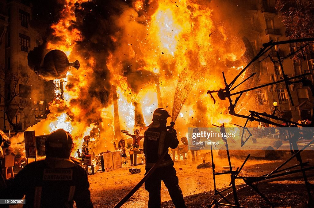 Firefighters put out a Falla during the last day of the Las Fallas Festival on March 20, 2013 in Valencia, Spain. The Fallas festival, which runs from March 15 until March 19, celebrates the arrival of spring with fireworks, fiestas and bonfires made by large puppets named Ninots.