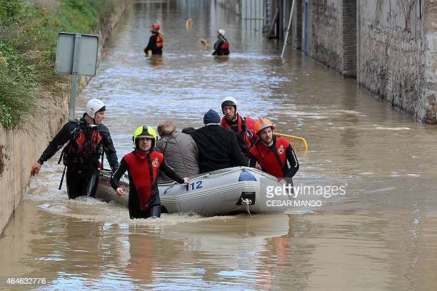 Firefighters rescue an elderly couple from their flooded home after the river Ebro in Tudela broke its banks after heavy rainfall on February 27 2015...