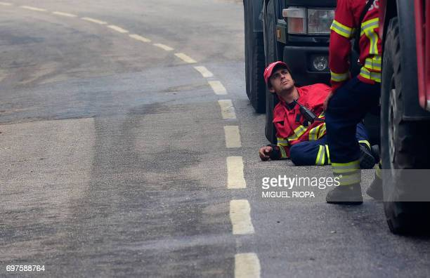 Firefighters rest between their trucks close to the village of Aguda on June 19 2017 More than 1000 firefighters are still trying to control the huge...