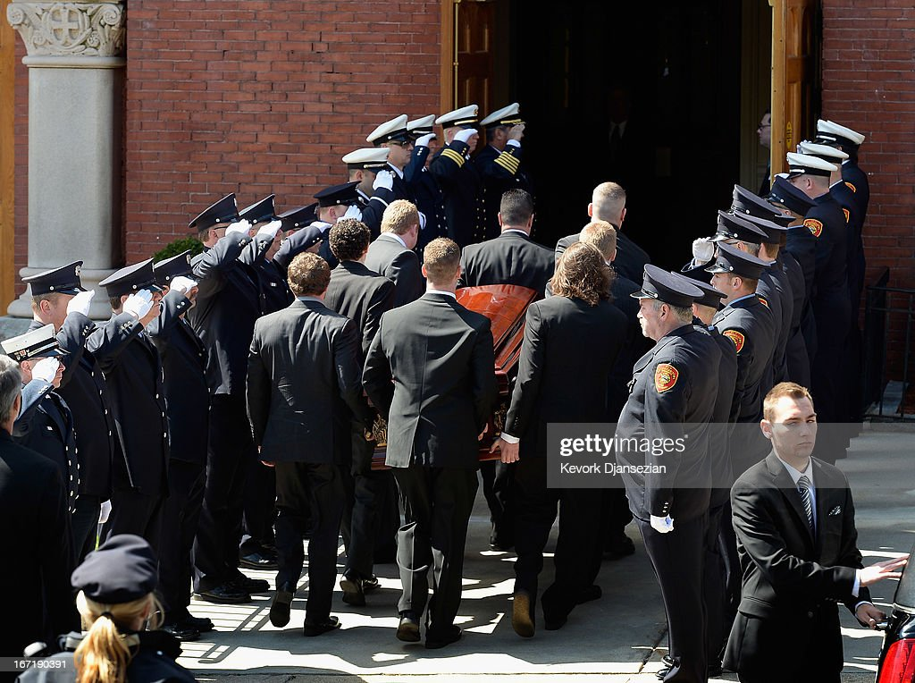 Firefighters salute as pallbearers carry the casket of Krystle Campbell, a victim of the Boston Marathon bombing, to St. Joseph Catholic Church for her funeral on April 22, 2013 in Medford, Massachusetts. A manhunt ended for Dzhokhar A. Tsarnaev, 19, a suspect in the Boston Marathon bombing after he was apprehended on a boat parked on a residential property in Watertown, Massachusetts. His brother Tamerlan Tsarnaev, 26, the other suspect, was shot and killed after a car chase and shootout with police. The bombing, on April 15 at the finish line of the marathon, killed three people and wounded at least 170.