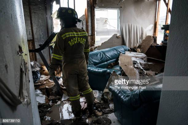 Firefighters search for survivors at an apartment complex in Rockport TX as Hurricane Harvey hits the Texas coast on Saturday Aug 26 2017