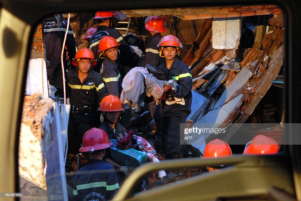 Firefighters search for survivors following twin blasts which tore through a residential street and destroyed three houses in Ho Chi Minh City early on February 24, 2013 killing up to 10 people, according to some reports. Police said authorities were investigating the cause of the explosions in a district of the southern metropolis of Ho Chi Minh City, adding that they were believed to have been accidental. AFP PHOTO / Vietnam News Agency