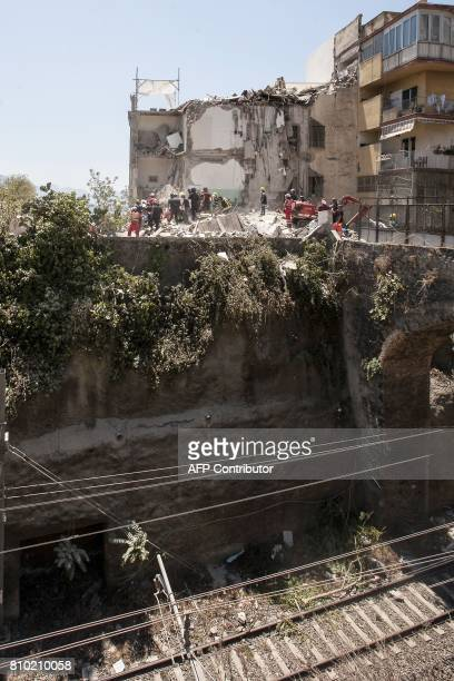 Firefighters search the rubble after two floors collapsed in a small fourstorey building in Torre Annunziata in a town near the Italian city of...