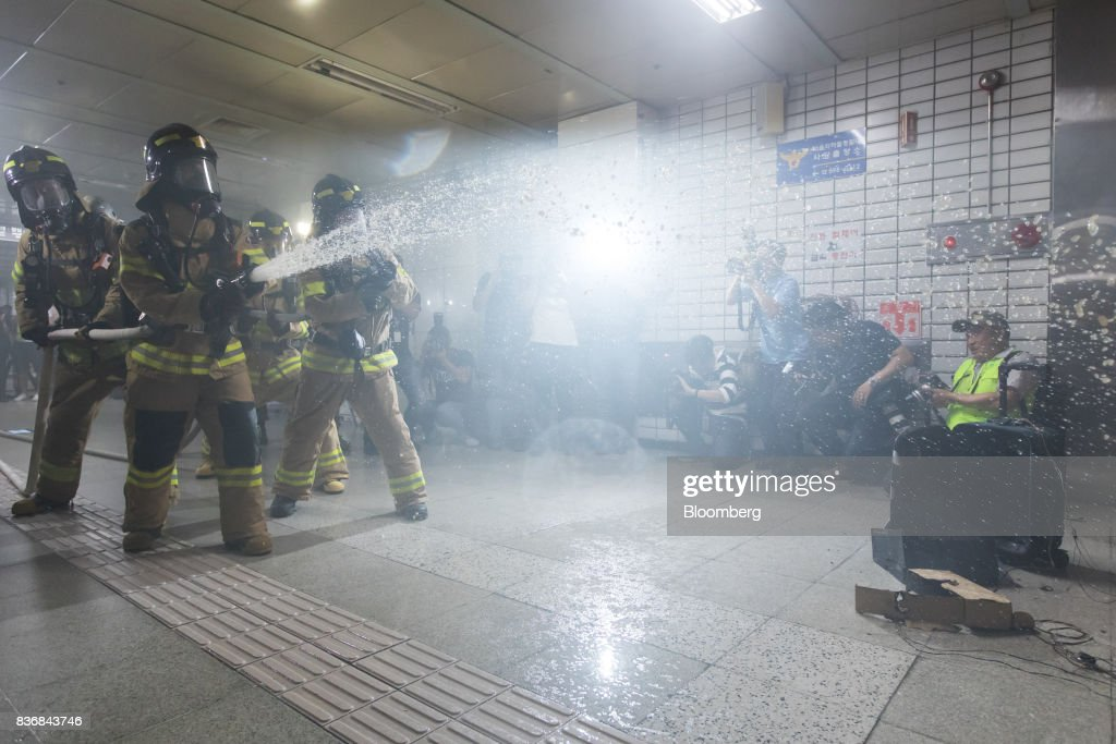Firefighters spray their hose during an anti-terror drill on the sidelines of the Ulchi Freedom Guardian (UFG) military exercises at a subway station in Seoul, South Korea, on Tuesday, Aug. 22, 2017. North Korea warned the U.S. on Tuesday it will face 'merciless revenge' for ignoring Pyongyangs warnings over annual military drills with South Korea. Photographer: SeongJoon Cho/Bloomberg via Getty Images