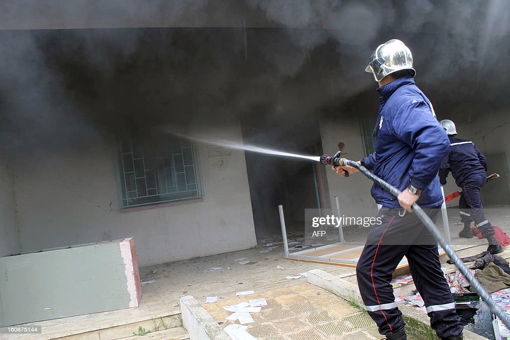 Firefighters spray water to extinguish the fire that consumes an office of the ruling Islamist Ennahda party in Siliana, northwest of TunisA picture taken on February 7, 2013. Protesters torched and ransacked the house to protest against the assassination of vocal government critic Chokri Belaid while spontaneous protests erupted in a dozen towns and cities in Tunisia despite the premier's attempts to defuse the crisis by pledging to form a new government.