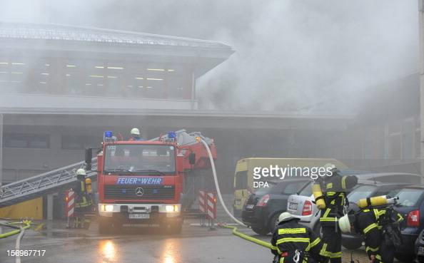 Firefighters stand in front of house with a workshop for handicapped people in Titisee Neustadt southern Germany on November 26 2012 Fourteen people...