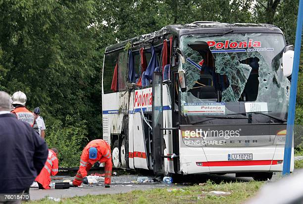 Firefighters stand next to a Polishregistered coach after they righted it on a motorway in northern France some 10 kilometers outside Dunkirk 08...